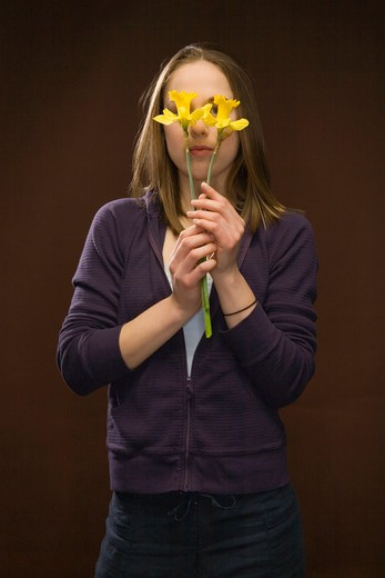Young Woman Holding Daffodils : Stock Photo