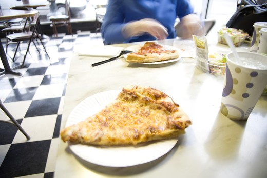 Stock Photo: 1626R-19897 Pizza on a Cafe Table