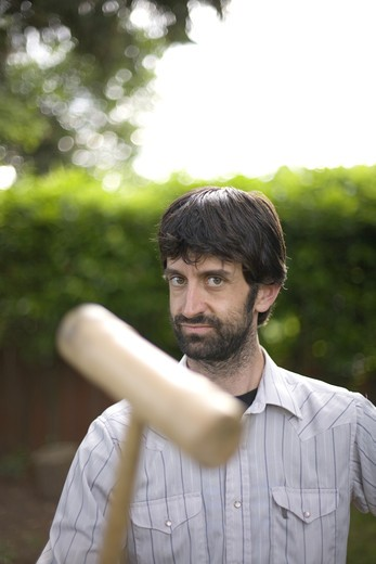 Man with Croquet Mallet in Garden : Stock Photo