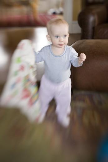 Baby Walking with Blanket : Stock Photo