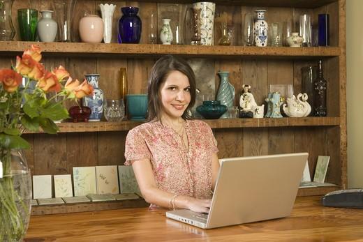 Florist on Laptop : Stock Photo