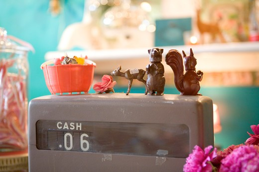 Plastic Figurines on an Old Cash Register : Stock Photo