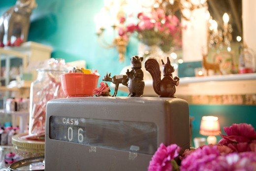 Stock Photo: 1626R-21928 Plastic Figurines on an Old Cash Register