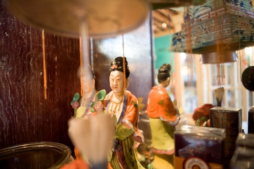 Japanese Figurine and Mirror : Stock Photo