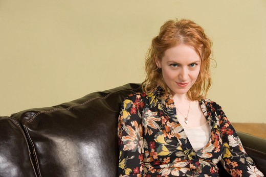 Woman Sitting on Couch : Stock Photo