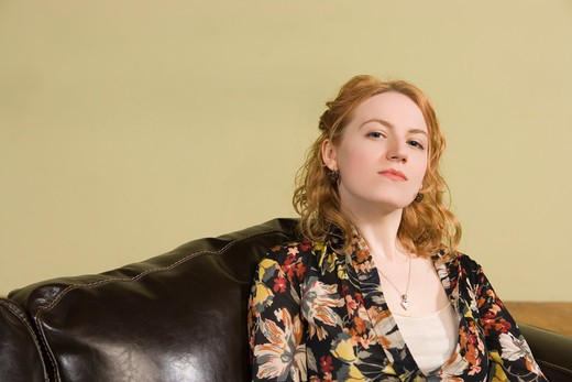 Stock Photo: 1626R-22043 Woman Sitting on Couch