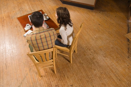 Stock Photo: 1626R-22199 Woman and Man with Notebook and Laptop in Empty Room