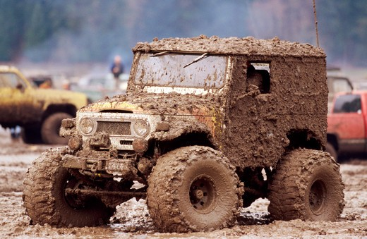 Truck Driving Through Mud : Stock Photo