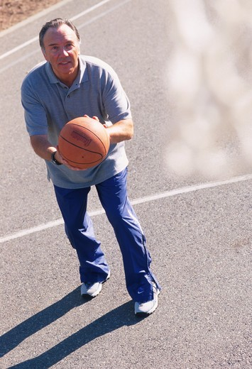 Man Shooting Basketball on Court : Stock Photo