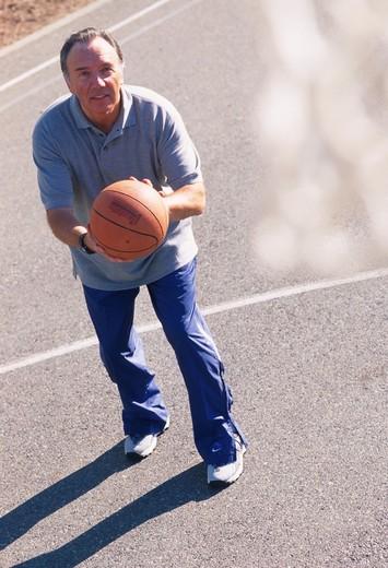 Stock Photo: 1626R-2794 Man Shooting Basketball on Court