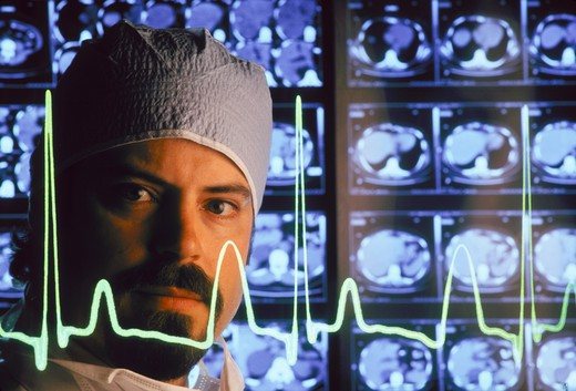 Doctor with MRIs and Heart Line : Stock Photo