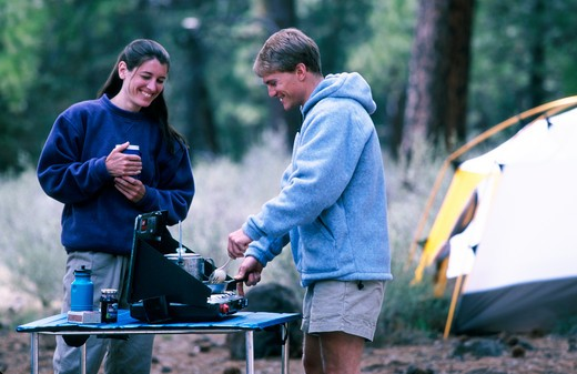 Stock Photo: 1626R-3273 Couple Cooking While Camping