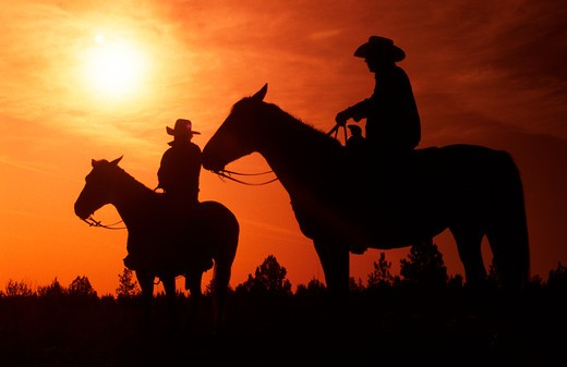 Stock Photo: 1626R-3564 Cowboys at Sunset