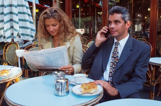 Man and Woman at Outdoor Cafe : Stock Photo