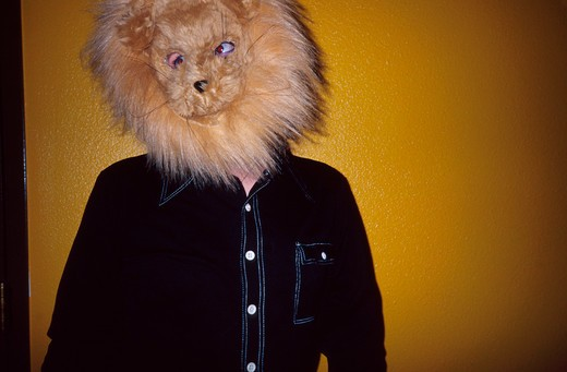 Stock Photo: 1626R-5012 Person Wearing Lion Mask