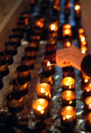 Lighting Prayer Candles : Stock Photo
