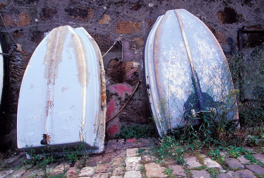 Stock Photo: 1626R-6836 Boats Leaning Against a Wall
