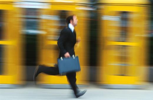 Running Businessman : Stock Photo