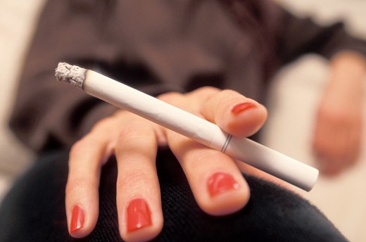 Stock Photo: 1626R-7296 Woman's Hand Holding a Cigarette