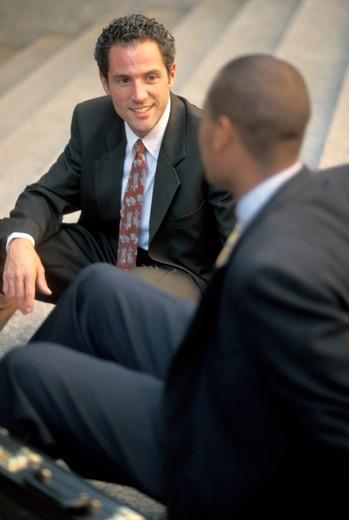 Stock Photo: 1626R-7315 Buisnessmen Talking