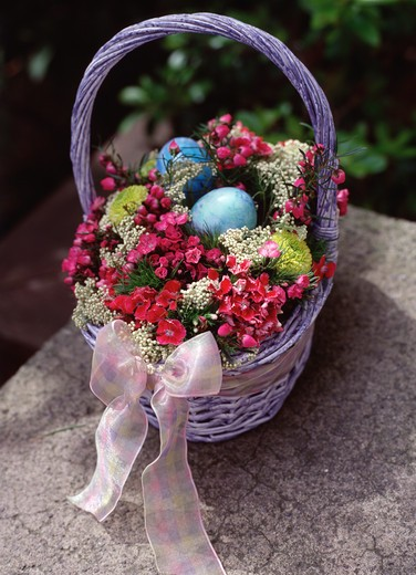 Basket of Flowers and Easter Eggs : Stock Photo