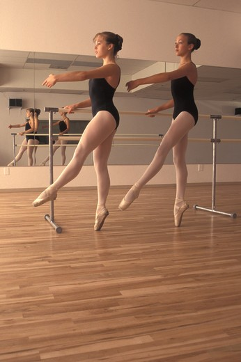 Stock Photo: 1626R-8084 Ballet dancers practicing, low angle view