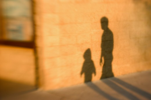 Shadow of father and son : Stock Photo