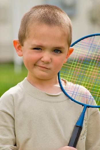 Stock Photo: 1626R-8829 Boy (6-7) holding racket, portrait