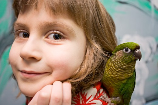 Girl with parrot, portrait : Stock Photo