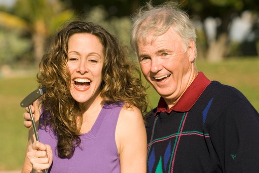 Stock Photo: 1626R-9140 Mature man with mid adult woman, smiling