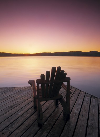 Chair on pier by sea : Stock Photo