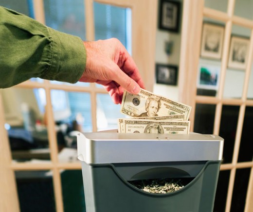Stock Photo: 1627-113 Close-up of a person's hands shredding paper currency