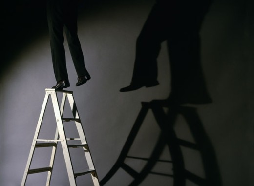 Low section view of a businessman falling from a step ladder : Stock Photo
