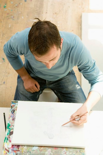 Stock Photo: 1631-142 High angle view of a young man drawing