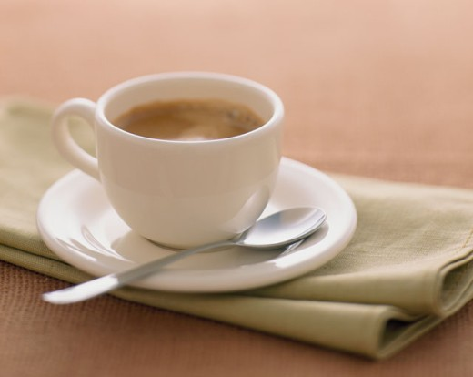 Close-up of a cup of coffee on a napkin : Stock Photo