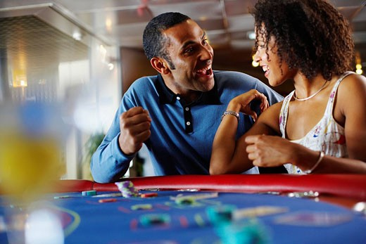 Excited Couple at Blackjack Table : Stock Photo