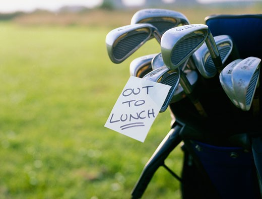 """""""Out To Lunch"""" Note Attached to Golf Clubs : Stock Photo"""