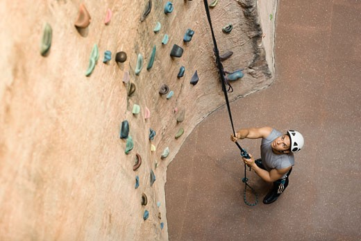 Man in Front of Climbing Wall : Stock Photo
