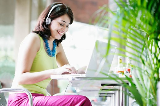 Young Woman in Wireless Internet Cafe : Stock Photo