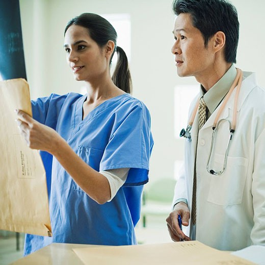 Doctors Looking at X_Ray : Stock Photo
