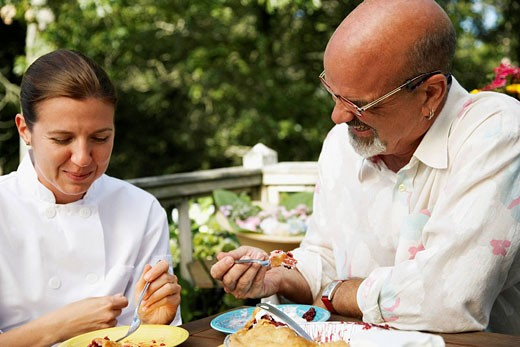 Couple Eating Dessert : Stock Photo