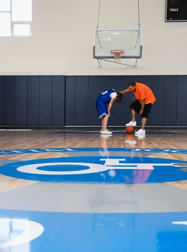 Student and Coach on Basketball Court : Stock Photo