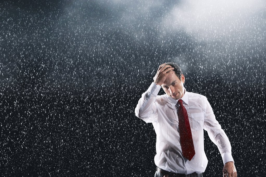 Businessman Standing in the Rain : Stock Photo
