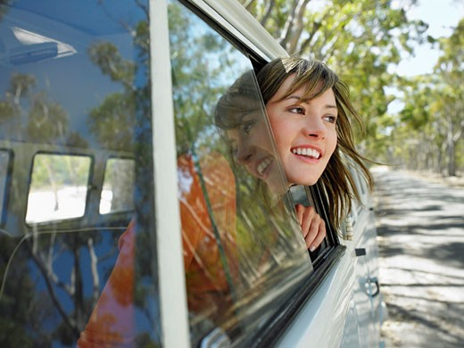 Stock Photo: 1654-12483 Young Woman Leaning out of Van Window half length