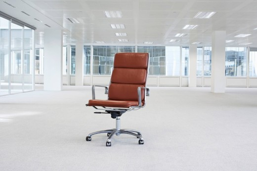 Swivel chair in empty office space : Stock Photo