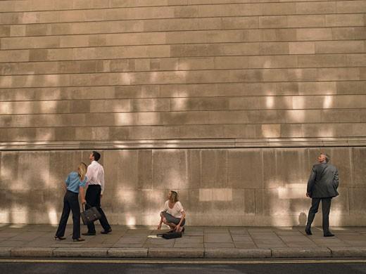 People on sidewalk looking up : Stock Photo