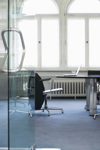 Empty conference room with laptop on table : Stock Photo