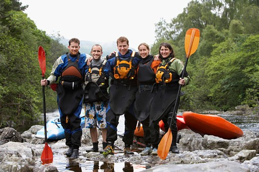 Group of people with kayaks by river portrait : Stock Photo