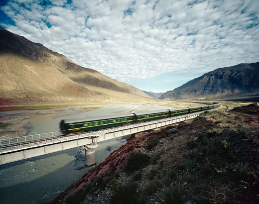 High Speed Train Traveling Through Valley : Stock Photo
