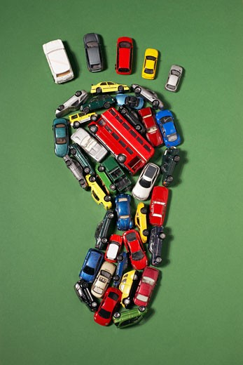 Footprint shape made of toy cars : Stock Photo